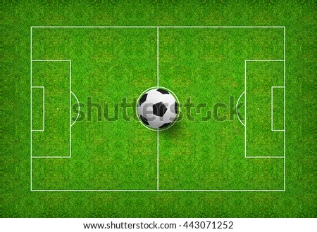 Top views of soccer ball on green grass of soccer field background with pattern and texture. - stock photo
