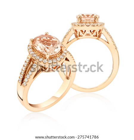 Topaz and diamond pink gold ring. isolate on white