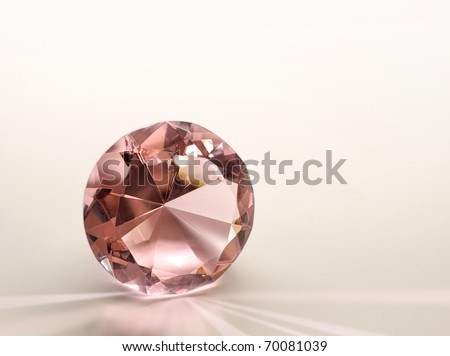 Topaz gemstone diamond shining on light pink background - stock photo