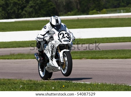 TOPEKA, KS - AUG 2:  AMA Superbike racer, Aaron Yates, travels through the turns at the Tornado Nationals presented by BriggsAuto.com on Aug 2, 2009 in Topeka, KS. - stock photo