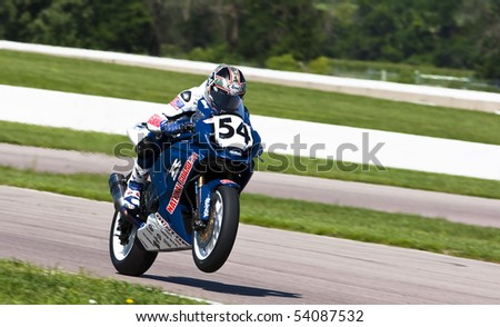 TOPEKA, KS - AUG 2:  AMA Superbike racer, Geoff May, travels through the turns at the Tornado Nationals presented by BriggsAuto.com on Aug 2, 2009 in Topeka, KS. - stock photo