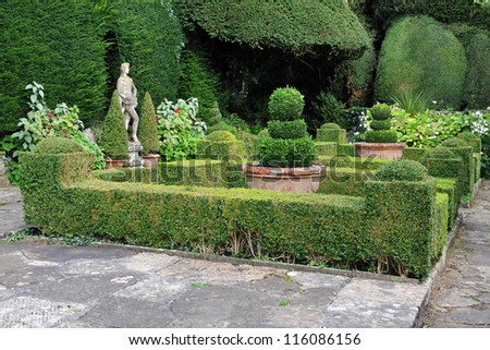 Topiary Landscaping in a Formal English Garden - stock photo
