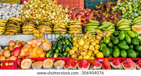 Topical market with mangoes, plaintains and coconuts on Curacao - stock photo