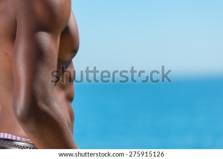 Topless African man against blue background