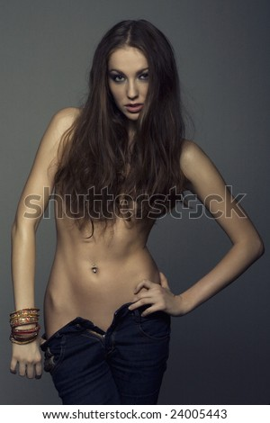 topless girl in jeans with bracelets - stock photo