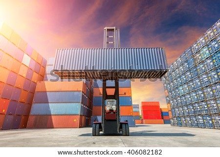 Toplift handling container box loading to freight contrainer. - stock photo