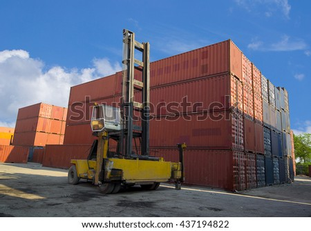 Toplift handling container box loading to freight train. - stock photo