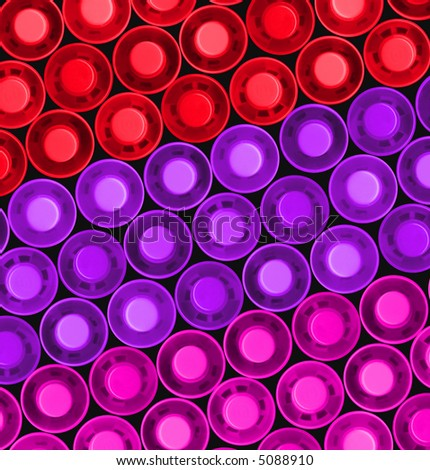 tops of red purple pink highlighter pens in a diagonal pattern - stock photo