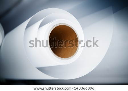 Topshot macro Paper roll in a printshop - stock photo