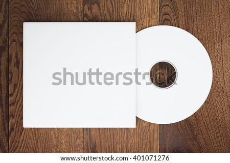 Topview of blank white compact disk with cover on wooden table. Mock up, 3D Rendering - stock photo