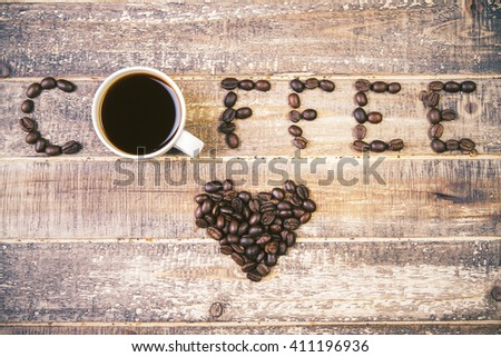 Topview of table with coffee mug and beans - stock photo