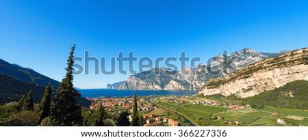 Torbole and Garda Lake - Trentino Italy / Lago di Garda (Garda Lake) of glacial origin, Sarca river and Torbole, small town in Trentino Alto Adige, Italy, Europe - stock photo