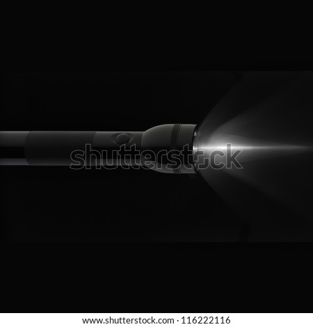 torchlight emitted by an electric torch over a black background - stock photo