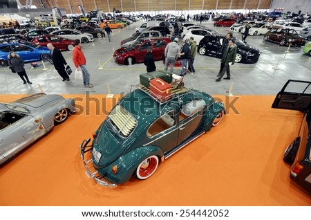 TORINO, ITALY - FEBRUARY 15, 2015: A Exposition of different and colored tuned cars on display at Expo Tuning Torino. Special edition of Volkswagen Beetle in Torino business place on February 15, 2015 - stock photo