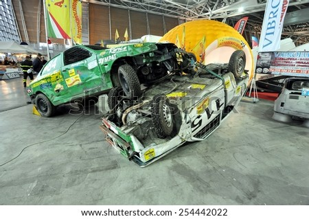 TORINO, ITALY - FEBRUARY 15, 2015: A Exposition of different Rally cars on display at Expo Tuning Torino. Special edition of off road vehicle flipped in Torino business place on February 15, 2015 - stock photo