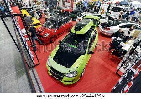 TORINO, ITALY - FEBRUARY 15, 2015: A Exposition of different tuned cars on display at Expo Tuning Torino. Special edition of new Volkswagen Golf in Torino business place on February 15, 2015 - stock photo