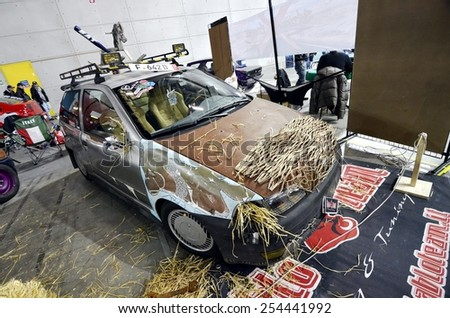 TORINO, ITALY - FEBRUARY 15, 2015: Vintage custom Fiat Punto in Rat-style or Rat-Rod. It's a new generation of tuning, usually crummy looking exterior with rust colored parts on February 15, 2015 - stock photo