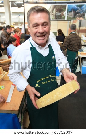 TORINO, ITALY - OCT. 24: Talking with traditional Bitto cheese producer at Salone del Gusto, international fair of tastes and slow food October 24, 2010 in Torino, Italy. - stock photo