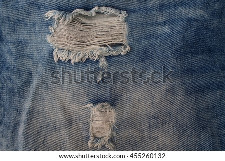 Torn blue jeans texture