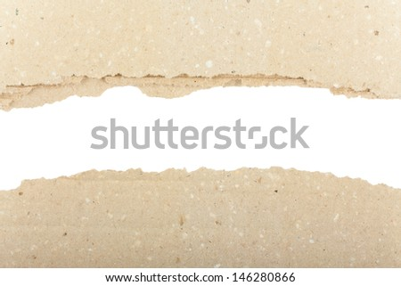 Torn brown paper with space for your message - stock photo