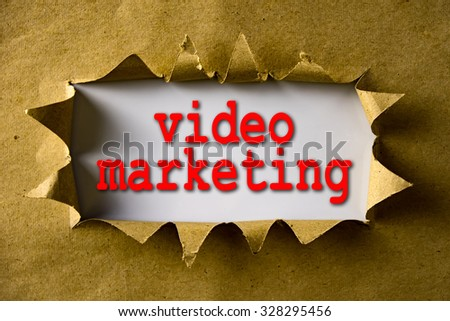 Torn brown paper with word Video Marketing - stock photo