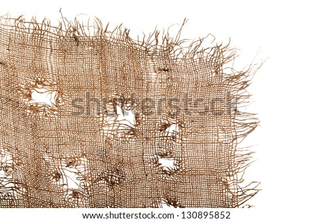 Torn burlap decayed. Ragged linen fabric. The isolation of each cell between threads. - stock photo