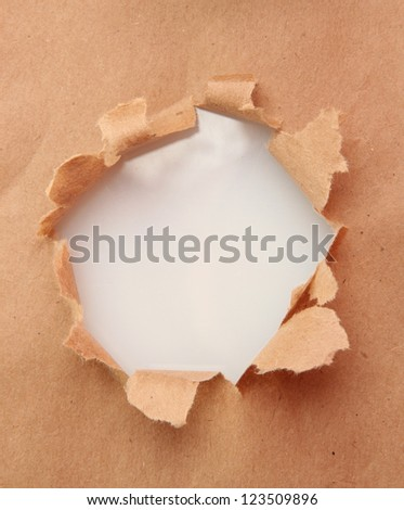 Torn craft paper background - stock photo