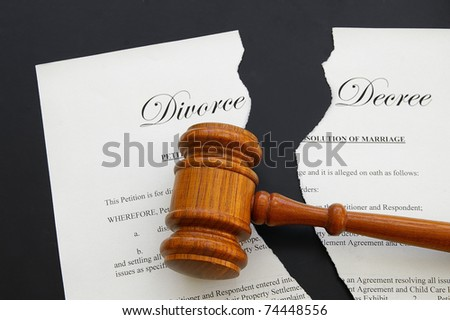 torn divorce decree and legal gavel (gavel is sharp) - stock photo