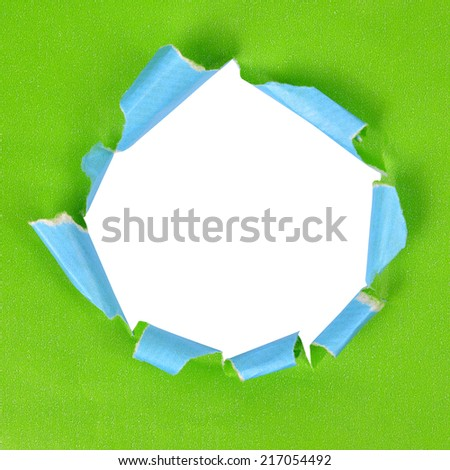 Torn green paper, isolated on white background.