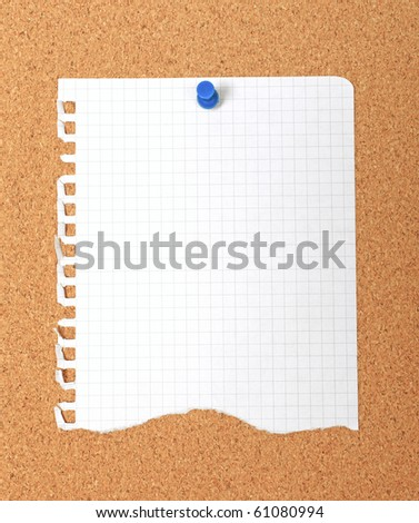 Torn note paper attached with blue pin to cork board, good as background or backdrop. - stock photo