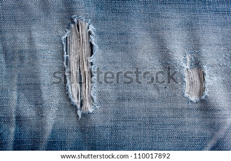 torn old blue jeans background - stock photo