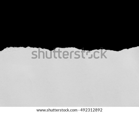 torn or ripped pieces of paper in black background
