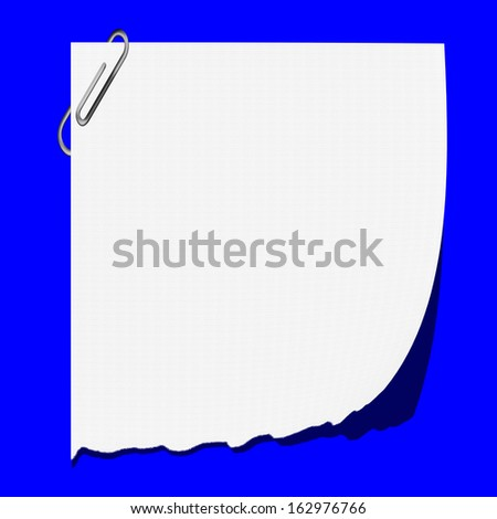Torn paper attached with a clip. on a blue background. - stock photo