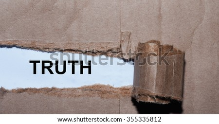 Torn paper box with word truth in low light - stock photo