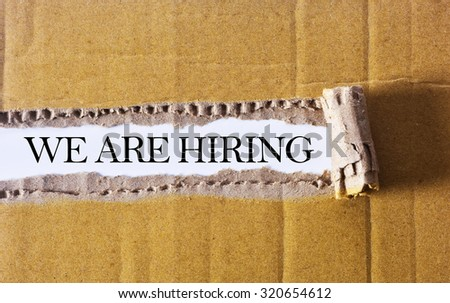 Torn paper box with word We Are Hiring - BUSINESS CONCEPT - stock photo
