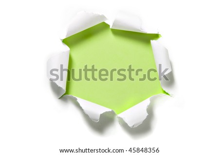 Torn Paper Circle on Green. Focus on curled edges of paper - stock photo