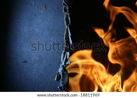 Torn paper over fire flames abstract background - stock photo