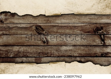 torn paper over the wooden background - stock photo