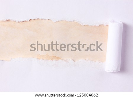 Torn paper  with brown background - stock photo