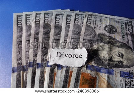 Torn paper with Divorce text on hundred dollar bills                                - stock photo