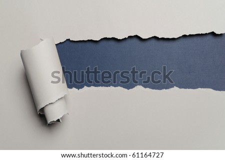 Torn paper with opening showing dark blue background - stock photo