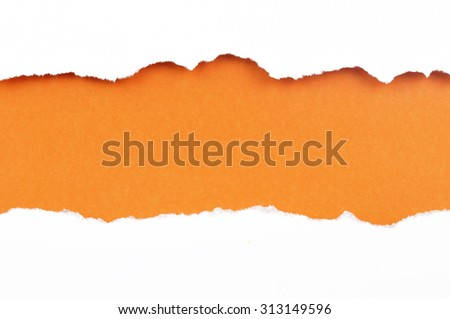 torn paper with space for your message . white paper ripped apart showing underlying orange layer. - stock photo