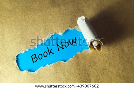 Torn paper with word book now - stock photo