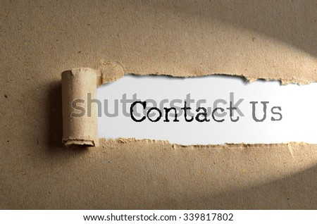Torn paper with word Contact Us - stock photo