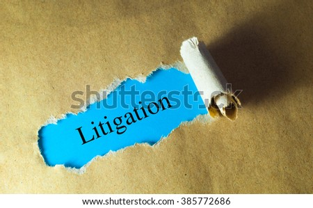 torn paper with word litigation - stock photo