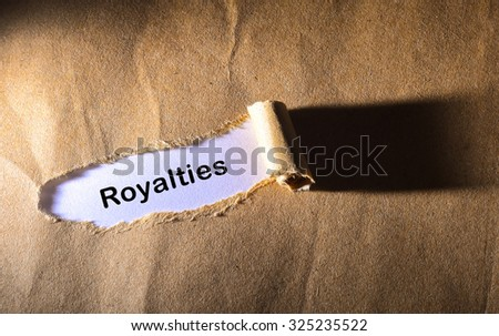 Torn paper with word Royalties - stock photo