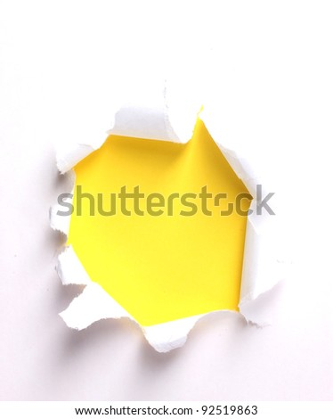 Torn paper  with yellow background - stock photo