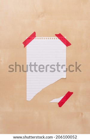 Torn Piece of Paper On Wooden Notice Board With Space For Text. - stock photo