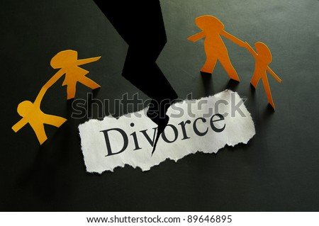 torn piece of paper with divorce text and paper family figures