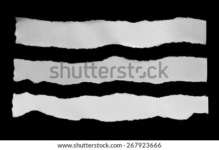 Torn pieces of paper on black background - stock photo
